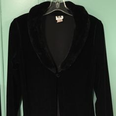"""80's Vintage Maxi Velvet Coat w/ Faux Fur  Collar Wow. What a fashion statement. A full length velvet coat, single button at the neck with a soft faux fur collar. All the rage in the 80's. Making a comeback in the fashion world today. In excellent condition ❤️made in the USA. 53""""inches from top of the shoulder to bottom of the coat  B.B. Apparel  Jackets & Coats"""