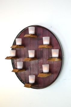 Wine Barrel Head Candle / Flower holder  by winecountrycraftsman. I'm not a fan of the dead flowers but pretty neat idea with the candles.