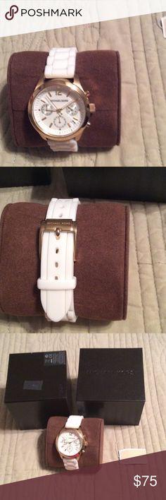 Michael kors watch Worn a few times . Needs a new battery. Michael kors watch . White band. Includes original box . KORS Michael Kors Accessories Watches