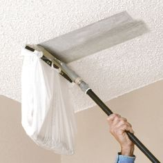 You can attach a plastic bag to this Popcorn Ceiling Scraper from Homax to make scraping your old acoustic ceiling a breeze. And it'll only take 30 minutes to do a 10'x10' room!