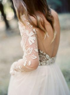 Beaded illusion sleeve wedding dress: http://www.stylemepretty.com/2015/11/27/autumn-bridal-session-in-yosemite-national-park/   Photography: Cassidy Carson - http://www.cassidycarsonphotography.com/