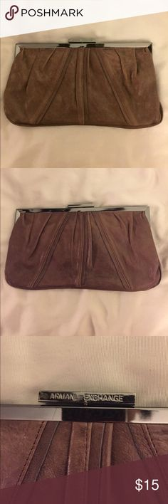 """A/X Armani Exchange Brown leather clutch A/X Armani Exchange Brown leather clutch handbag. Brown leather upper with brown cotton lining. One inner zipper side pocket. Pewter tone metal closure at top. Clutch measures 11"""" x 6"""". Minor scratches on outer leather. Stains on inner cotton lining. Please see pics. Sorry no trades. Offers welcome! A/X Armani Exchange Bags Clutches & Wristlets"""