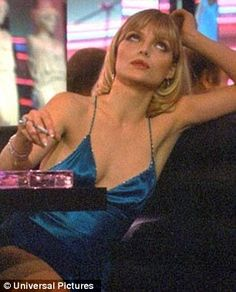 Michelle Pfeiffer in 'Scarface' – 1983 - Memorable Hair and Beauty Moments From the Movies - Photos Elvira Scarface, Scarface Film, Scarface Quotes, Scarface Poster, Cinema Movies, Movie Tv, Michelle Pfeiffer Scarface, Elvira Hancock, Al Pacino