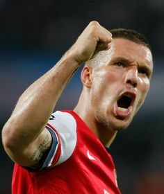 Lucas Podolski celebrates his goal for Arsenal in the Champions League game against Montpellier.