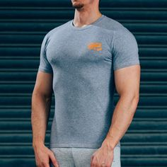 FormFit T-Shirt - Grey & OrangeShipping: PROCESSING TIME 3 - 4 Days ESTIMATED DELIVERY TIME 3 - 4 days for Domestic 4 - 6 days for International Superior quality cotton t-shirt, simple design, tapered fit to showcase your physique. Designed with quality in mind, the same great feel after multiple washes, good as new for years to come. Styled for all day wear: complete with orange printed logos & contrast stitching. #Musclesnotincluded 95% cotton, 5% Elastane Model is 5'11'' and wears an M…