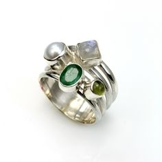 Istanbul £39.00 Four banded ring of silver set with emerald, peridot, pearl and moonstone