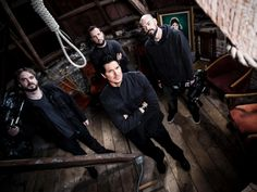 Ghost Adventures: Zak, Aaron, Billy, and Jay pose together in the attic of the Manresa Castle.