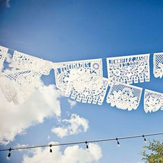 White paper banners from Mexican Sugar Skull; Floral design by Wedding Flowers by Lisa; Photo by Ashley K. Photography #weddings #decor