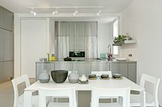 HomeSphere in Solid Flint, Private Residence - stunning chrome units, white furniture and minimal styling, all warmed up by a green-grey resin floor! Wall Finishes, Plaster Walls, Stainless Steel Kitchen, Minimalist Kitchen, White Furniture, Green And Grey, Minimalism, Kitchens, Chrome