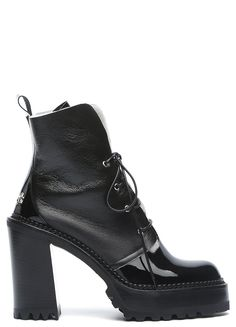 65741f73bb92a Fur lined heeled ankle high boot from Premiata. A round toe