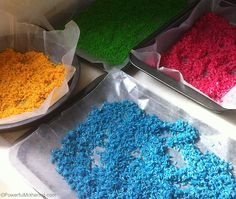 color rice drying on baking sheets with wax paper
