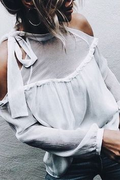 Pretty white cold shoulder blouse.