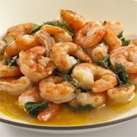 24 large frozen shrimp (peeled and deveined)  1/2 C spinach leaves, chopped  1 tsp olive oil  1 clove garlic, crushed  1/2 tsp dried basil  1 or 2 splashes of hot sauce