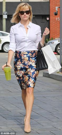 Blooming radiant: The Legally Blonde star was seen on Tuesday grabbing lunch in an exotic floral print pencil skirt, teamed with a white button up shirt and nude pumps