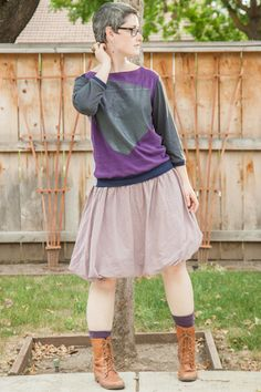 Purple and gray Printa recycled sweatshirt, lavender bubble skirt, purple socks, cognac Steve Madden Troopa boots.