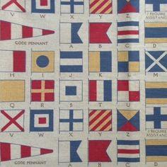 semaphore fabric by Sarah Hardaker. Available from Victoria Clark Interiors.
