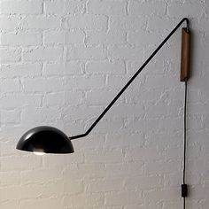 Shop mantis wall sconce.   Sculptural silhouette tells a tall tale with a midcentury twist.  Space-saving design hits a dramatic peak and swivels with a 360-degree shade rotation, shining light any direction you need it.