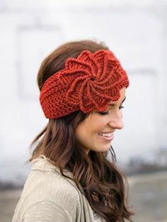 """This great headband/ear warmer works up quickly in any worsted-weight yarn. It is sized to fit most adult heads, and has 2 buttons so it's fully adjustable. The spiral flower is a great attention-grabber and unique from other flower headbands. Size: To fit Teen through Adult; head circumference 19"""" through 22"""". Made with medium (worsted) weight yarn and sizes G/6/4mm and I/9/5.5mm hooks. Skill Level: Intermediate to Experienced"""