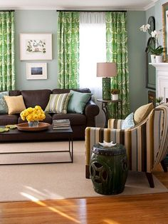 Another view of the cheerful, colorful living room with lots of light and natural influences. Sky blue, grassy green and sunny yellow colors set a cheerful, natural scene in which the chocolate brown sofa adds its earthy feel. The patterns add to the character of the room. I love rooms with character!