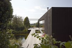 Teichhaus by HPSA / micro house / black wood / outdoor space / pool