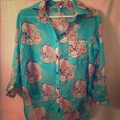 Turquoise Sugar Skull Floral Button Down Top Turquoise Sugar Skull Floral Button Down Sheer Top Gold buttons Good, gently loved condition with roll up sleeves. NO TRADES Tops Button Down Shirts