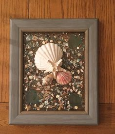"""13""""x 11"""" Beach Glass Wall and/or Window Art/Seashell Art/Resin Art/Unique Coastal Decor/Sun Catcher/Beach House Decor/Great Christmas Gift  Handmade in South Carolina with high quality materials (knobby starfish, beach glass, seashells, crushed shells, crushed glass) and secured with care. The"""