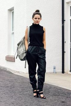 Chic leather trousers, a sleeveless turtleneck, complete with wide strappy sandals and a top bun. Yes, please.