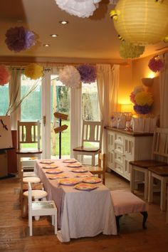 Winnie the Pooh Party room.  yellow Asian lantern with honey bees