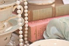 Teacups, books, pearls, and china. Simply luxurious!