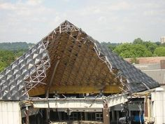 The interior of the infamous Dolphin Centre roof exposed during demolition, 30 July 2004.  http://www.romford.org/sports/swimming/dolphin/dolphin11.htm