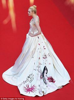 CANNES Film Festival May 2017 ELLE FANNING Red carpet royalty: Willowy Elle was the picture of confidence as she posed elegantly in h...