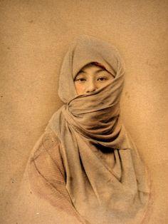 Japanese girl -Tintedalbumen print from a japanese photo album of the 19th century.