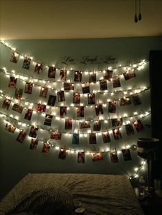 Photos clipped on a piece of string with clothes pins + Christmas lights