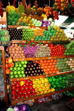 Colorful fruit and veggie stand. We had a road side farm stand like this in 1950's Ohio.