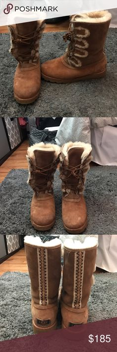 Authentic Ugg Rommy Lace Up Boots Worn two or three times at the most. Last time worn it started snowing so they do have some small marks on them that are pictured. The fur on the inside still looks brand new. Always worn with socks. Super cozy and warm. They are chestnut suede UGG Shoes Winter & Rain Boots