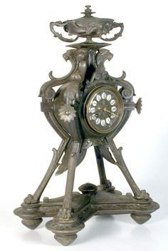 Dating from the mid to late 1800's, this fanciful clock features four lion heads supporting an urn at the top and four pawed feet to stand on. The clock is spelter with an enamel face, it has it's key and is working, however the chime is seems anaemic. The clock works were made in France by S Marti et Cie.