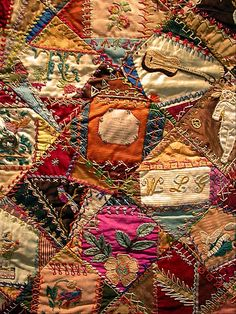 "I ❤ crazy quilting, & embroidery . . .   Crazy Quilt 2- I am so impressed by the embroidery on this quilt. Someone put in a printed piece (the one in the center here), entitled ""Love's Blessing."" It's cool how much creativity they had before TV rotted people's brains, and the time to carry out their vision, too!"