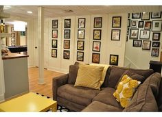 AWESOME basement remodel with kids' area, bathroom, TV room, dining/crafting/game room, and bar.