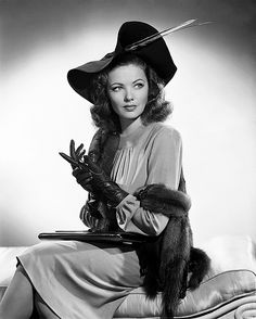 The style of a time gone by:  hat, gloves, mink stole, laptop...no wait, that's her purse (Gene Tierney)