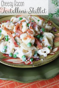 Tortellini in a creamy alfredo sauce and tossed with peas and BACON!