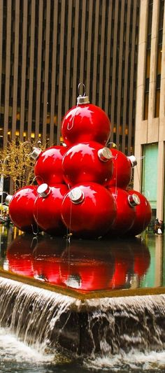 Giant red ornaments at 1251 Sixth Avenue, near Rockefeller Plaza in NYC.  New York City Christmas decorations.  Top 10 things to do in NYC in December, during the holidays
