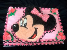 - A 12x18 sheet vanilla sheet cake with a strawberry Minnie Cake on top.  Done for my cousin's 2nd birthday.  The theme was pink, white and black so this is what I came up with.  They were thrilled!