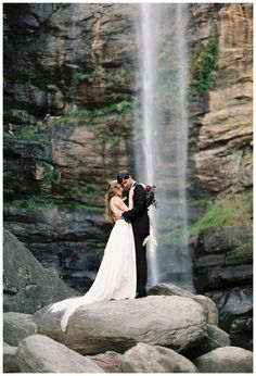 Bride and groom at Toccoa Falls in Georgia. Bouquet by Lauren Emerson Events & Design. Dress by Carol Hannah. Black and white image by Melanie Gabrielle.