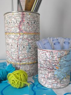 ♥ this idea...Wrap cans in maps to hold forks, knives & spoons for party