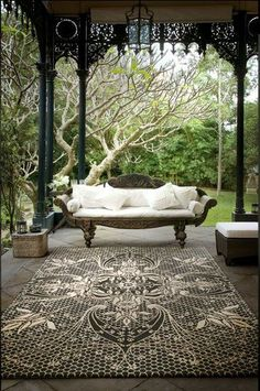 respecting each piece...i'd remove everything (including the canopy) and keep just the Balinese couch