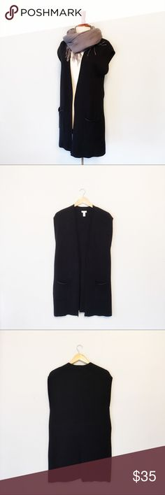 Chico's Long Black Sleeveless Duster Size 1/med/8 Chico's Long Black Sleeveless Duster  Details: * Chico's Size 1 = Med/8 * 60% cotton 40% rayon * Front pockets * Hand wash dry flat * EUC  * Pet free smoke free  Measurements taken flat * Bust:   * Length:   E.12.17 Chico's Sweaters Shrugs & Ponchos