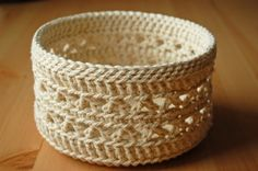 This is an item from my String Ensemble made from a chunky cotton craft string, cream coloured with a lovely lace pattern. Approx. measurements: Diameter: 15 cm, height 8.5 cm (Diameter: 6 inches, height: 3.2 inches) It is ideal for storage - anything from your current crochet or knitting project, ribbons, yarns, other craft accessories, to playing cards, small puzzles etc.- and helps you organise and decorate at the same time. Also perfect as a hamper basket for presenting a selection o...