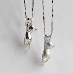 This cute, silver kitty cat charm pendant necklace is fun to wear and has a matching pair of earring, a matching bracelet as well as a matching ring that you can buy too! They'll go perfect with your