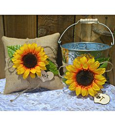 Here's a Sunflower Wedding Set with Burlap Ring Bearer Pillow and Flower Girl Pail.  With the personalized wood heart, this set is a great idea for any sunflower themed wedding. www.sherisewsweet.etsy.com