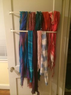 An ingenious way to hang your scarves--inexpensive curtain rods on the back of the door.